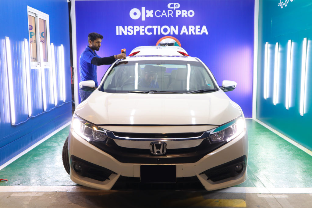OLX CarPro Inspector carrying out a car inspection at the facilitation center in Lahore.