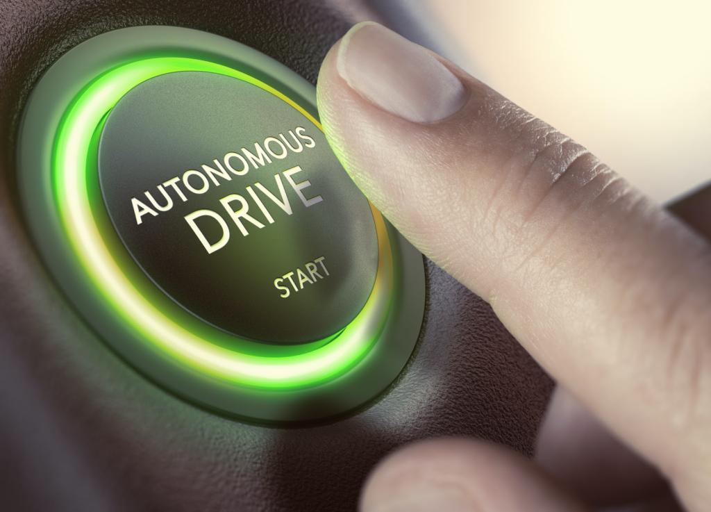 generic image of a finger about to press an autonomous drive start button.