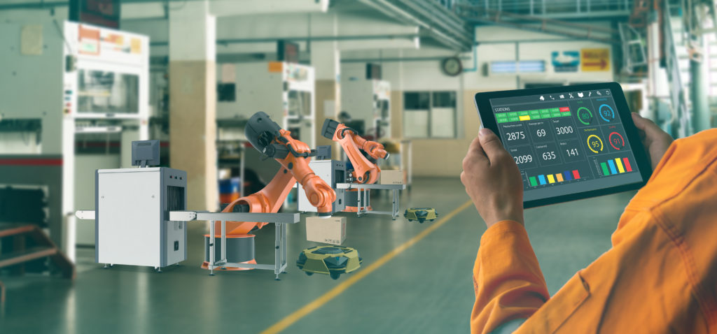 Man tracking inventory in factory using 5G