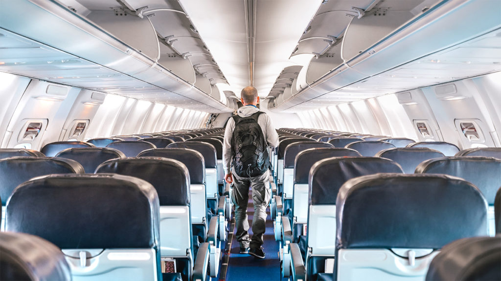 Passenger in empty airplane due to Covid-19 travel restrictions